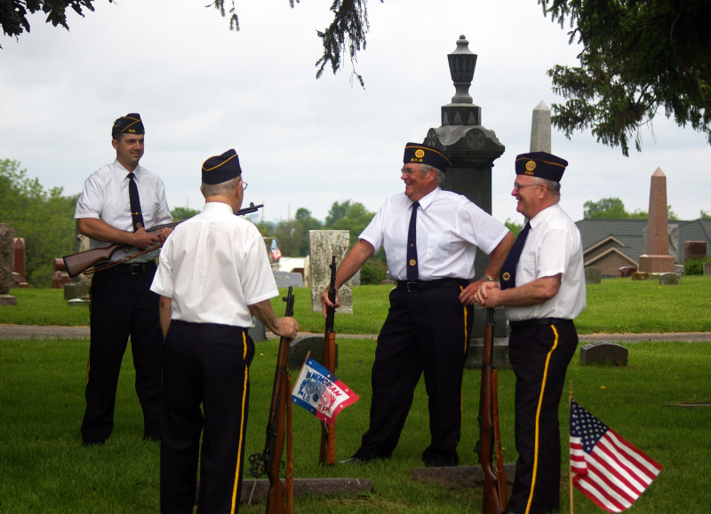 Members of Post 555 Honor Guard chat before the service.