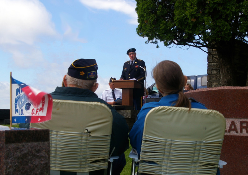 Post 555 member and World War II veteran Glen Klinsky and a family member enjoy the program.