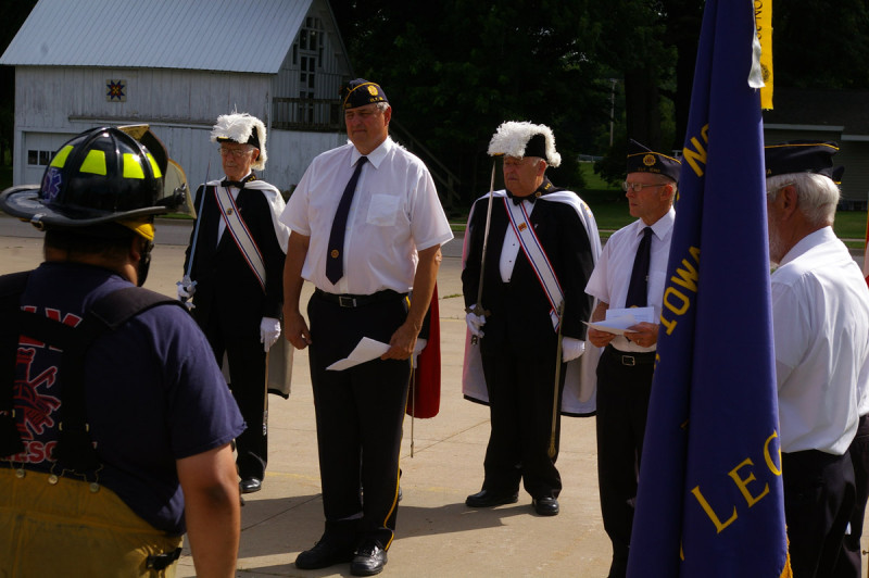Legionnaires Ed Mertins and Bob Jacobs along with members of the Knights of Columbus stand at attention during the ceremony.